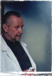 Jeffrie Peterson as the Coroner
